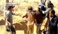 khadafi torture