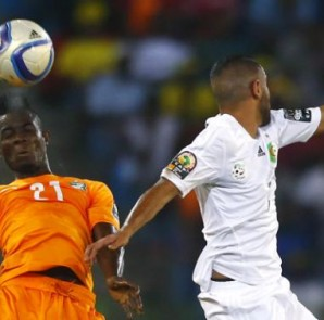 Ivory Coast's Eric Bailly fights for the ball with Riyad Mahrez of Algeria during their quarter-final soccer match of the 2015 African Cup of Nations in Malabo
