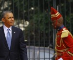 U.S. President Obama is followed by a member of honor guard at the Presidential Palace in Dakar
