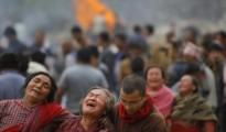 Family members break down during the cremation of earthquake victims inBhaktapur near Kathmandu, Nepal, Sunday, April 26, 2015. A strong magnitude 7.8 earthquake shook Nepal's capital and the densely populated Kathmandu Valley before noon Saturday, causing extensive damage with toppled walls and collapsed buildings, officials said. (AP Photo/Niranjan Shrestha)