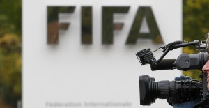 A cameraman films in front of the main entrance of the Home of FIFA in Zurich October 19, 2010. FIFA has launched a formal investigation into allegations that two executive committee members had offered to sell votes in the in the contest to host the 2018 World Cup.  REUTERS/Christian Hartmann  (SWITZERLAND - Tags: SPORT SOCCER IMAGES OF THE DAY) - RTXTL7H