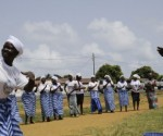 """Members of the Women In Peacebuilding Network ( WIPNET) dance and pray on May 8, 2015 in Monrovia. If there are no new infections in the next 48 hours, the World Health Organization (WHO) will declare Liberia """"Ebola-free"""" on May 9, 2015, 42 days -- or twice the incubation period of the virus -- after the last case.  AFP PHOTO / ZOOM DOSSO        (Photo credit should read ZOOM DOSSO/AFP/Getty Images)"""