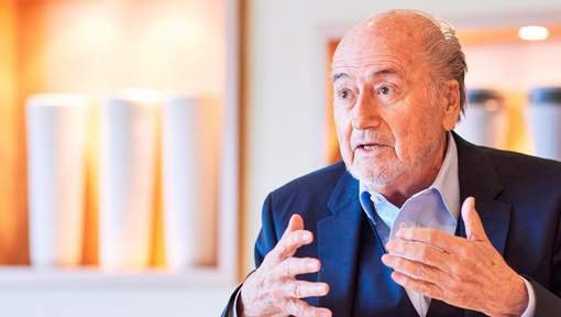 Former FIFA president Sepp Blatter gives an interview to news agencies